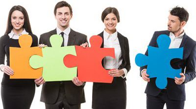 People Holding Multicolored Puzzle Pieces
